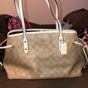 Excellent used condition three pocket coach bag